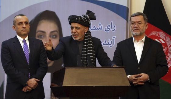 Second Vice President Sarwar Danish, right, Afghan President Ashraf Ghani, center and first Vice President Amrullah Saleh, attend a ceremony for Ghani winning a 2nd term in the presidential election, in Kabul, Afghanistan, Wednesday, Feb. 19, 2020. (AP Photo/Rahmat Gul)