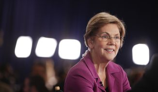 Sen. Elizabeth Warren, D-Mass., talks in the spin room after a Democratic presidential primary debate Wednesday, Feb. 19, 2020, in Las Vegas, hosted by NBC News and MSNBC. (AP Photo/Matt York)