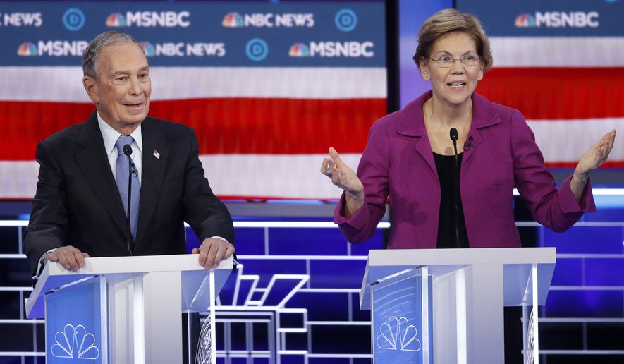 Democratic presidential candidates Sen. Elizabeth Warren, D-Mass., right, speaks as former New York City Mayor Mike Bloomberg looks on during a Democratic presidential primary debate Wednesday, Feb. 19, 2020, in Las Vegas, hosted by NBC News and MSNBC. (AP Photo/John Locher)