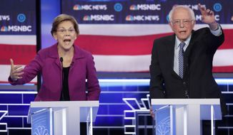 Democratic presidential candidates, Sen. Elizabeth Warren, D-Mass., left, and Sen. Bernie Sanders, I-Vt., gesture during a Democratic presidential primary debate Wednesday, Feb. 19, 2020, in Las Vegas, hosted by NBC News and MSNBC. (AP Photo/John Locher)