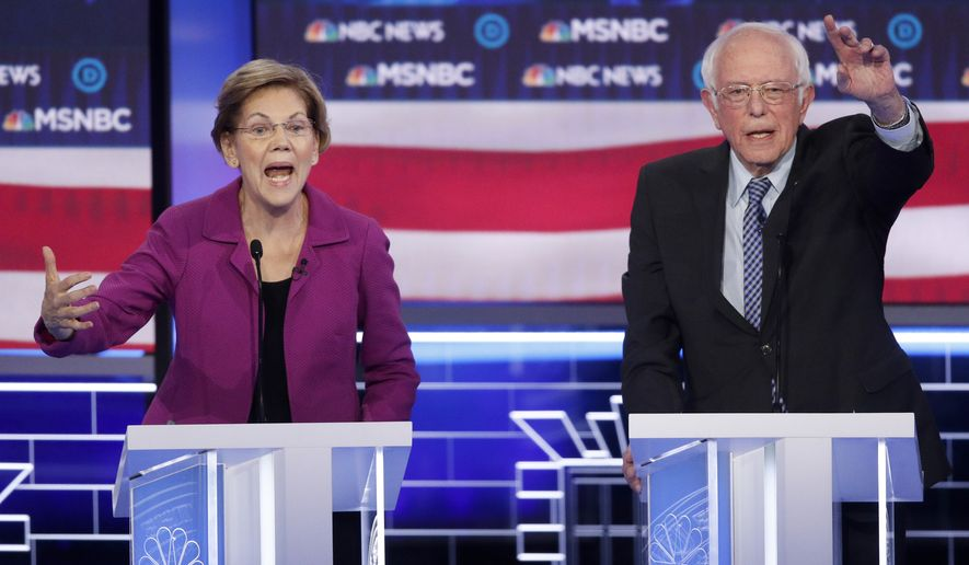 Democratic presidential candidates, Sen. Elizabeth Warren, D-Mass., left, and Sen. Bernie Sanders, I-Vt., gesture during a Democratic presidential primary debate Wednesday, Feb. 19, 2020, in Las Vegas, hosted by NBC News and MSNBC. (AP Photo/John Locher)
