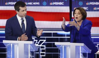 Democratic presidential candidates, Sen. Amy Klobuchar, D-Minn., right, speaks as former South Bend Mayor Pete Buttigieg looks on during a Democratic presidential primary debate Wednesday, Feb. 19, 2020, in Las Vegas, hosted by NBC News and MSNBC. (AP Photo/John Locher)