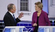 Democratic presidential candidate, former New York City Mayor Mike Bloomberg talks with Sen. Elizabeth Warren, D-Mass., during a break at a Democratic presidential primary debate Wednesday, Feb. 19, 2020, in Las Vegas, hosted by NBC News and MSNBC. (AP Photo/John Locher)