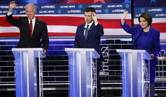Former Vice President Joe Biden, from left, former South Bend Mayor Pete Buttigieg, Sen. Amy Klobuchar, D-Minn., gesture during a Democratic presidential primary debate Wednesday, Feb. 19, 2020, in Las Vegas, hosted by NBC News and MSNBC. (AP Photo/John Locher)