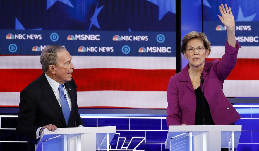 Democratic presidential candidate, former New York City Mayor Mike Bloomberg speaks as Sen. Elizabeth Warren, D-Mass., gestures during a Democratic presidential primary debate Wednesday, Feb. 19, 2020, in Las Vegas, hosted by NBC News and MSNBC. (AP Photo/John Locher)