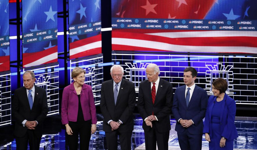 From left, Democratic presidential candidates, former New York City Mayor Michael Bloomberg, Sen. Elizabeth Warren, D-Mass., Sen. Bernie Sanders, I-Vt.,former Vice President Joe Biden, former South Bend Mayor Pete Buttigieg, Sen. Amy Klobuchar, D-Minn., stand on stage before a Democratic presidential primary debate Wednesday, Feb. 19, 2020, in Las Vegas, hosted by NBC News and MSNBC. (AP Photo/John Locher)