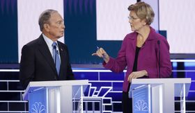 Democratic presidential candidates, former New York City Mayor Mike Bloomberg, left, and Sen. Elizabeth Warren, D-Mass., talk before a Democratic presidential primary debate Wednesday, Feb. 19, 2020, in Las Vegas, hosted by NBC News and MSNBC. (AP Photo/John Locher)