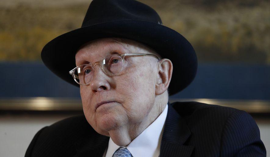 Former U.S. Sen. Harry Reid listens during an interview Wednesday, Feb. 19, 2020, in Las Vegas. (AP Photo/John Locher)