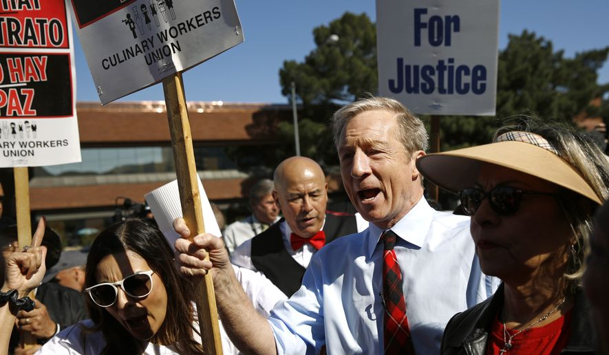 Democratic presidential candidate, businessman Tom Steyer walks on a picket line with members of the Culinary Workers Union Local 226 outside the Palms Casino in Las Vegas, Wednesday, Feb. 19, 2020. (AP Photo/Patrick Semansky)