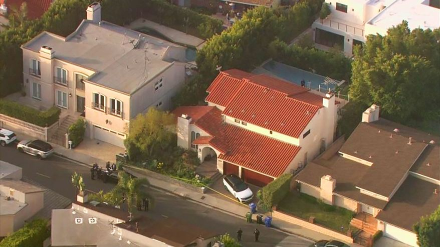 """This aerial photo taken from video provided by Fox11 News KTTV-TV shows the Hollywood Hills home, center, where Pop Smoke, 20, was shot and killed early Wednesday, Feb. 19, 2020, in Los Angeles. Republic Records says in a statement that the label is devastated by the unexpected and tragic loss of the rapper. The shooting occurred before dawn Wednesday. Public listings show that the home which is a rental is owned by Edwin Arroyave and his wife Teddi Mellencamp, daughter of singer John Mellencamp and star of """"The Real Housewives of Beverly Hills."""" (Fox11 News KTTV-TV via AP)"""