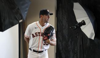 Houston Astros pitcher Justin Verlander poses for a photographer during photo day before a spring training baseball practice Tuesday, Feb. 18, 2020, in West Palm Beach, Fla. (AP Photo/Jeff Roberson)