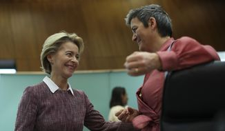 Eeuropean Commission President Ursula von der Leyen, left, talks to Commissioner for Europe Fit for the Digital Age Margrethe Vestager during a weekly College of Commissioners meeting at the EU headquarters in Brussels, Wednesday, Feb. 19, 2020. During the meeting, the College will set out plans on the EU's strategy to deal with the challenges of the digital age and the use of artificial intelligence. (AP Photo/Francisco Seco)
