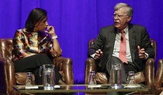 Former national security advisers Susan Rice, left, and John Bolton take part in a discussion on global leadership at Vanderbilt University, Wednesday, Feb. 19, 2020, in Nashville, Tenn. (AP Photo/Mark Humphrey)