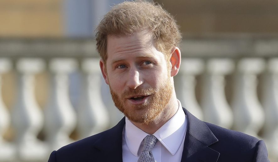 Britain's Prince Harry gestures in the gardens of Buckingham Palace in London, Thursday, Jan. 16, 2020. (AP Photo/Kirsty Wigglesworth)  ** FILE **