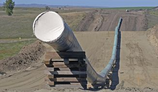 FILE - This Sept. 29, 2016, file photo, shows a section of the Dakota Access pipeline under construction near St. Anthony in Morton County, N.D. North Dakota regulators are expected to take action Wednesday, Feb. 19, 2020, on a proposal to expand the capacity of the Dakota Access pipeline.(Tom Stromme/The Bismarck Tribune via AP)