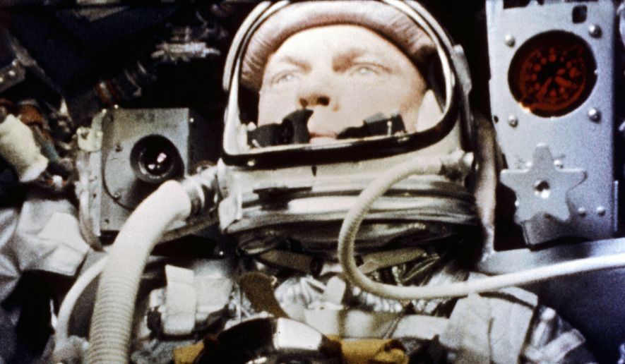 """FILE - In this Feb. 20, 1962, file photo, provided by NASA, astronaut John Glenn pilots the """"Friendship 7"""" Mercury spacecraft during his historic flight as the first American to orbit the Earth. Fans of the late astronaut are working to bring a statue of his likeness to the Ohio Statehouse to mark major future milestones, such as his birthday and the anniversary of his famous space flight. Thursday marks 58 years since Glenn became the first American to orbit the Earth, making him an instant national hero in 1962. (NASA via AP, File)"""
