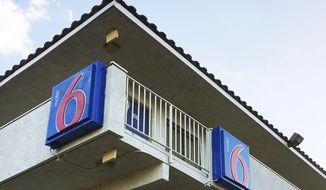 FILE _ This Sept. 14, 2017, file photo shows a Motel 6 in Phoenix. A judge has given final approval to a $10 million settlement in a class-action discrimination lawsuit that alleged Motel 6 employees in Phoenix shared the whereabouts and private information of guests with immigration authorities who later arrested some of them. (AP Photo/Anita Snow, File)