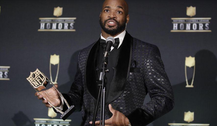 Washington Redskins' Adrian Peterson speaks after winning the Art Rooney Sportsmanship Award at the NFL Honors football award show Saturday, Feb. 1, 2020, in Miami. (AP Photo/Patrick Semansky)