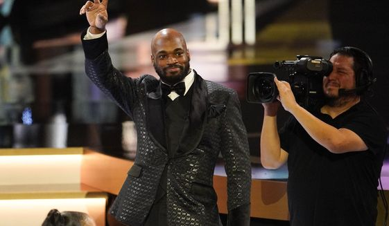 Washington Redskins' Adrian Peterson waves after given the Art Rooney Sportsmanship Award at the NFL Honors football award show Saturday, Feb. 1, 2020, in Miami. (AP Photo/David J. Phillip) ** FILE **