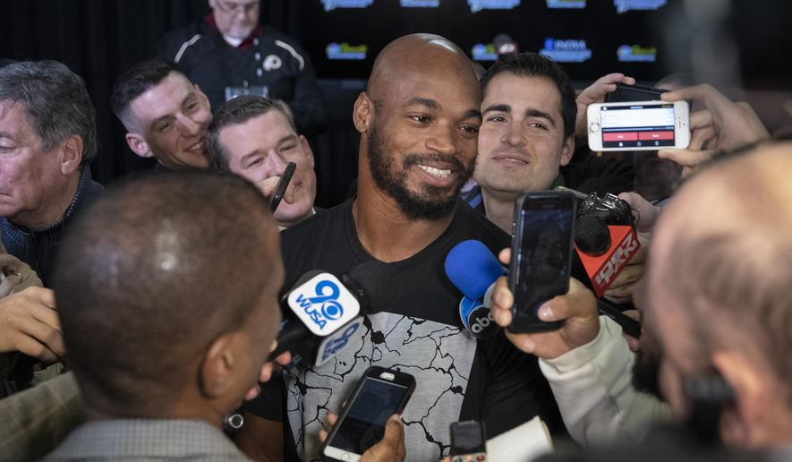 Washington Redskins running back Adrian Peterson smiles as he speaks with the media after a news conference with new head coach Ron Rivera at the team's NFL football training facility, Thursday, Jan. 2, 2020, in Ashburn, Va. (AP Photo/Alex Brandon)
