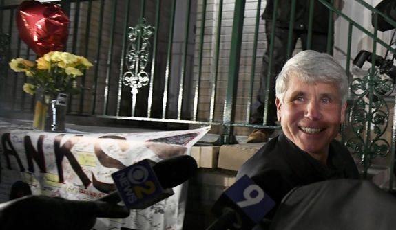 Former Illinois Gov. Rod Blagojevich smiles as he arrives home in Chicago on Wednesday, Feb. 19, 2020, after his release from Colorado prison late Tuesday. Blagojevich walked out of prison Tuesday after President Donald Trump cut short the 14-year prison sentence handed to the former Illinois governor for political corruption. (AP Photo/Paul Beaty)