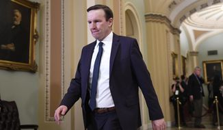 FILE - In this Feb. 3, 2020, file photo, Sen. Chris Murphy, D-Conn., walks on Capitol Hill in Washington, Murphy is defending a weekend meeting he held with Iran's foreign minister in Europe. The Connecticut Democrat said Tuesday his meeting with Mohammed Javad Zarif was important because it is dangerous not to talk to one's enemies. (AP Photo/Susan Walsh, File)
