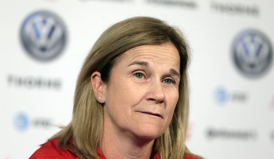 FILE - In this Friday, May 24, 2019 file photo, Jill Ellis, coach of the United States women's national soccer team, speaks to reporters during a news conference in New York. Newly hired American men's soccer coach Gregg Berhalter earned nearly as much from the U.S. Soccer Federation in the fiscal year ending last March 31 as women's counterpart Jill Ellis. Ellis, who took over as women's coach in May 2014, had compensation of $390,409 in the fiscal year. She went on to lead the Americans to their second straight World Cup title, was voted FIFA Women's Coach of the Year, then left in October. Any bonus she earned as a result of the title likely will be listed on the next year's tax return. (AP Photo/Seth Wenig, File)