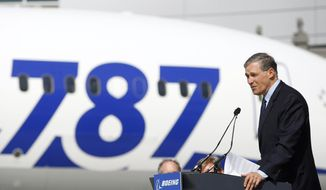 FILE - In this April 3, 2013 file photo, Washington Governor Jay Inslee speaks to workers in front of a Boeing 787 airplane during the grand opening of the new Boeing Everett Delivery Center in Everett, Wash. Washington state lawmakers announced Wednesday, Feb. 19, 2020 that they will introduce bills, at Boeing Co.'s request, to suspend the company's preferential business and occupation tax rate until there's a final determination from World Trade Organization regarding a long-running trade dispute. (Genna Martin/The Herald via AP, File)