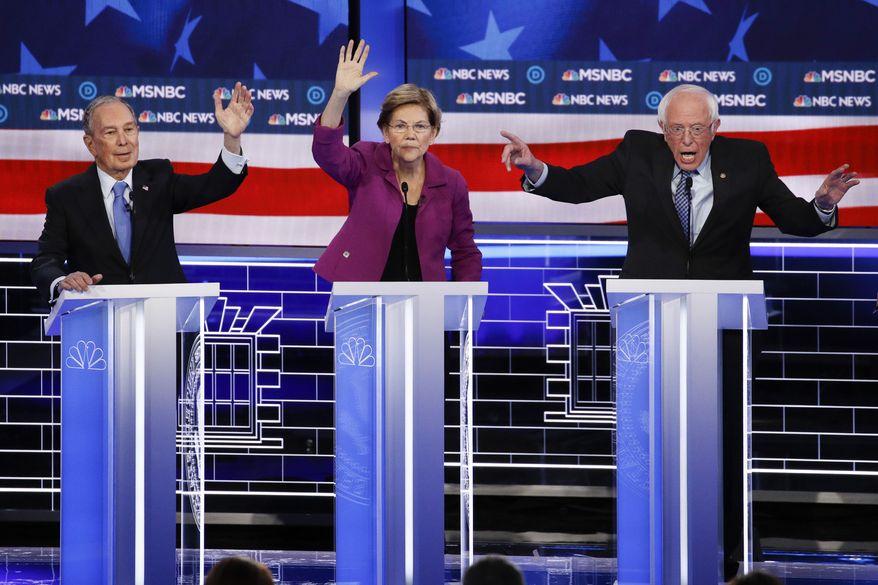From left, Democratic presidential candidates, former New York City Mayor Mike Bloomberg, Sen. Elizabeth Warren, D-Mass., Sen. Bernie Sanders, I-Vt., participate in a Democratic presidential primary debate Wednesday, Feb. 19, 2020, in Las Vegas, hosted by NBC News and MSNBC. (AP Photo/John Locher)