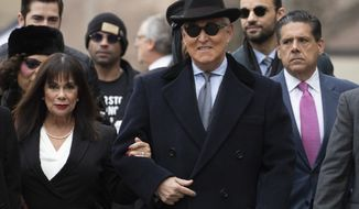 Roger Stone accompanied by his wife Nydia Stone, left, arrives for his sentencing at U.S. District Court in Washington, Thursday, Feb. 20, 2020. Stone, a staunch ally of President Donald Trump, faces sentencing Thursday on his convictions for witness tampering and lying to Congress. (AP Photo/Manuel Balce Ceneta)