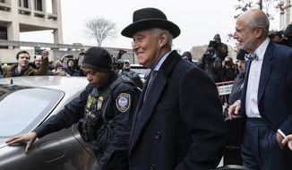 Roger Stone, center, departs federal court in Washington, Thursday, Feb. 20, 2020, in this file photo. On April 16, 2020, a federal judge rejected Stone's motion for a retrial, saying he had failed to establish that the jury forewoman was biased against him and that that prejudiced her decision to vote for his conviction. (AP Photo/Alex Brandon) **FILE**