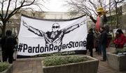 "Supporters of Roger Stone with a banner that reads ""#PardonRogerStone"" wait outside federal court in Washington, Thursday, Feb. 20, 2020. President Donald Trump loyalist and ally, Roger Stone was sentenced to over three years in federal prison, following an extraordinary move by Attorney General William Barr to back off his Justice Department's original sentencing recommendation. The sentence came amid President Donald Trump's unrelenting defense of his longtime confidant that led to a mini-revolt inside the Justice Department and allegations the president interfered in the case. (AP Photo/Manuel Balce Ceneta)"