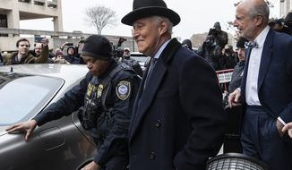 Roger Stone, center, departs federal court in Washington, Thursday, Feb. 20, 2020. President Donald Trump loyalist and ally, Roger Stone was sentenced to over three years in federal prison, following an extraordinary move by Attorney General William Barr to back off his Justice Department's original sentencing recommendation. The sentence came amid President Donald Trump's unrelenting defense of his longtime confidant that led to a mini-revolt inside the Justice Department and allegations the president interfered in the case. (AP Photo/Alex Brandon)