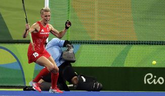 FILE - In this file photo dated Wednesday, Aug. 17, 2016, Britain's Alex Danson, celebrates after she scored her goal against New Zealand, during a women's field hockey semifinal match at 2016 Summer Olympics in Rio de Janeiro, Brazil.  Field hockey player Danson, who helped Britain win a gold medal at the 2016 Rio Olympics has announced her retirement Thursday Feb. 20, 2020, after failing to recover from head trauma caused by hitting a brick wall hard while laughing at a joke. (AP Photo/Hussein Malla, FILE)