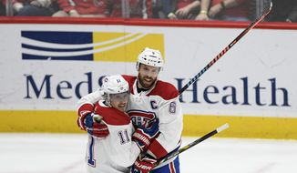 Montreal Canadiens right wing Brendan Gallagher (11) celebrates his goal with defenseman Shea Weber (6) during the second period of an NHL hockey game against the Washington Capitals, Thursday, Feb. 20, 2020, in Washington. (AP Photo/Nick Wass)