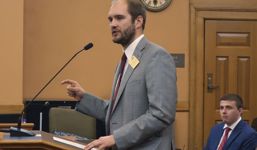 In this Wednesday, Feb. 19, 2020 photo, Zack Pistora, a lobbyist for the Sierra Club, testifies before the Kansas Senate Utilities Committee at the Statehouse in Topeka, Kan. Pistora and other environmentalists are frustrated that the Legislature isn't discussing climate change and considering proposals for combating it. (AP Photo/John Hanna)
