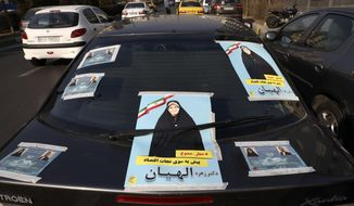 Posters of candidates for the upcoming parliamentary elections are displayed on a car, in Tehran, Iran, Tuesday, Feb. 18, 2020. Iranian authorities have barred thousands of parliamentary candidates from running, mainly reformists and moderates. Friday's elections could strengthen the hand of Iranian hard-liners, who champion confronting the West. (AP Photo/Vahid Salemi)