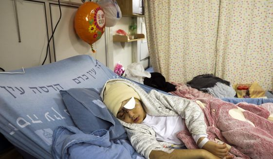A nine-year-old Palestinian boy Malik Eissa rests in Hadassa hospital in Jerusalem, Thursday, Feb. 20, 2020. Malik, who was shot in the face by Israeli police in a tense east Jerusalem neighborhood last week, will not regain vision in his left eye despite surgery, a local community leader who is in touch with the family said Thursday. (AP Photo/Mahmoud Illean)