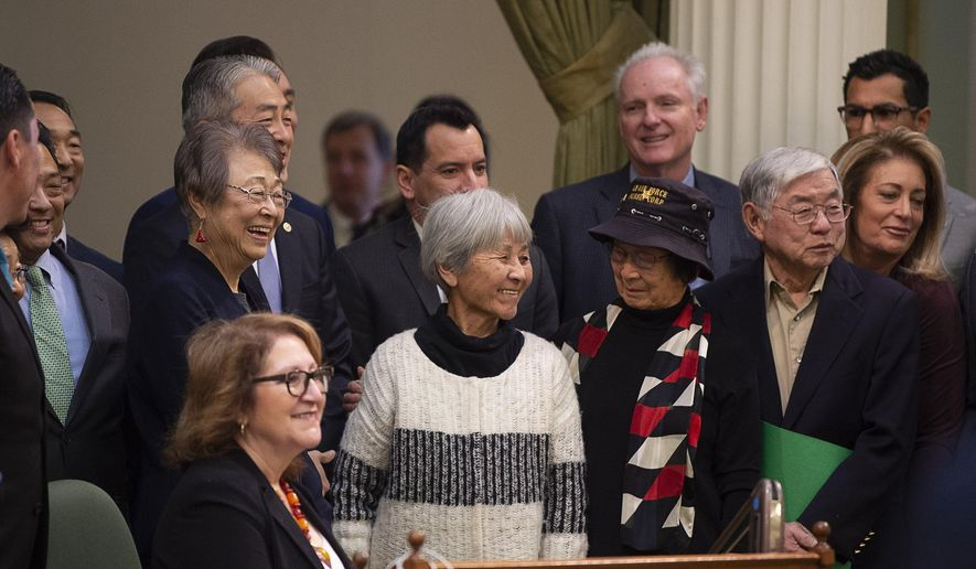 Assemblyman Al Muratsuchi, D-Torrance, in back, joins Japanese Americans who were incarcerated during World War II after the California Assembly passed House Resolution 77 on Thursday, Feb. 20, 2020, in Sacramento. Muratsuchi is the author of the resolution, which apologizes for the state's role in supporting the internment and its failure to protect the civil rights of citizens of Japanese ancestry. HR 77 passed one day after the anniversary of the signing of Executive Order 9066, which authorized the incarceration, by President Franklin D. Roosevelt in 1942. (Paul Kitagaki Jr./The Sacramento Bee via AP).