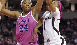 South Carolina's Zia Cooke (1) shoots while defended by LSU's Faustine Aifuwa during the first half of an NCAA college basketball game Thursday, Feb. 20, 2020, in Columbia, S.C. (AP Photo/Richard Shiro)