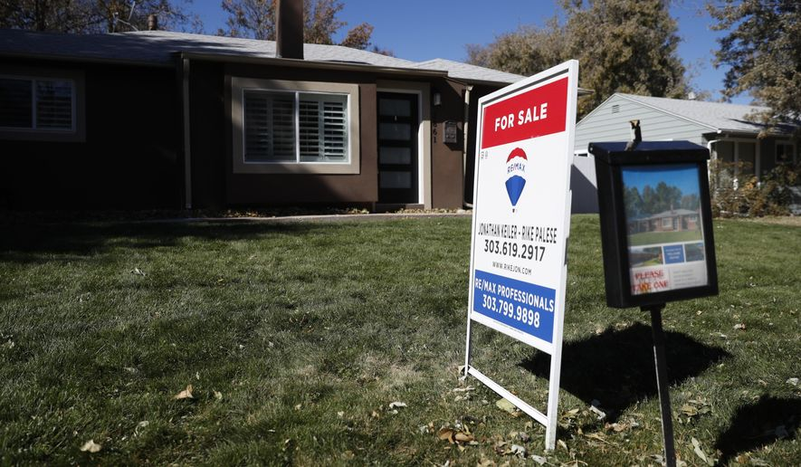 FILE - In this Oct. 22, 2019, file photo a sign stands outside a home for sale in southeast Denver. On Thursday, Feb. 20, 2020, Freddie Mac reports on this week's average U.S. mortgage rates. (AP Photo/David Zalubowski, File)