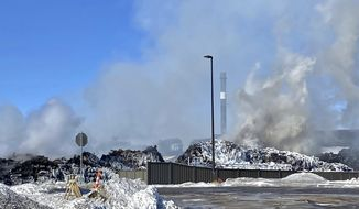 """A massive fire at Northern Metal recycling in Becker, Minnesota, that has been burning for days, seemed to be under control Thursday morning, Feb. 20, 2020. The Becker Police Department posted Thursday  that """"major progress"""" has been made and that fire crews report the fire is """"under control at this point.""""  (Brian Peterson/Star Tribune via AP)"""