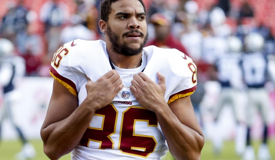 FILE - In this Oct. 21, 2018, file photo, Washington Redskins tight end Jordan Reed (86), warm up before an NFL football game against the Dallas Cowboys, in Landover, Md. The Washington Redskins have released injury prone tight end Jordan Reed, Thursday, Feb. 20, 2020. Washington creates $8.5 million in salary-cap by cutting ties with him. Reed missed all of last season with his fifth documented concussion of his seven-year NFL career. (AP Photo/Andrew Harnik, File)