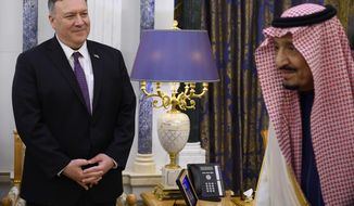 US Secretary of State Mike Pompeo, left, meets with Saudi King Salman, right, at the Royal Court in Riyadh, Saudi Arabia, Thursday Feb. 20, 2020. Pompeo has said that during his time in Saudi Arabia, he will speak with the kingdom's leadership about security issues, threats posed by Iran, the economic relationship between the two countries, and issues of human rights. (Andrew Caballero-Reynolds/Pool via AP)