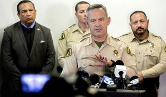 Riverside County Sheriff Chad Bianco provides update on the Perris triple homicide investigation during a news conference at the Riverside County Sheriff's Perris station on Tuesday, Feb. 18, 2020. Three adult males bodies were found yesterday at the Perris Valley Cemetery. (Watchara Phomicinda/The Orange County Register via AP)