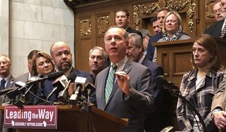 Wisconsin Assembly Speaker Robin Vos speaks to reporters in the Assembly chamber ahead of their final day in session Thursday, Feb. 20, 2020, in Madison, Wis. Vos says he hopes Democratic Gov. Tony Evers will sign into law a GOP income tax cut proposal passing the Legislature on Thursday. (AP Photo/Scott Bauer)