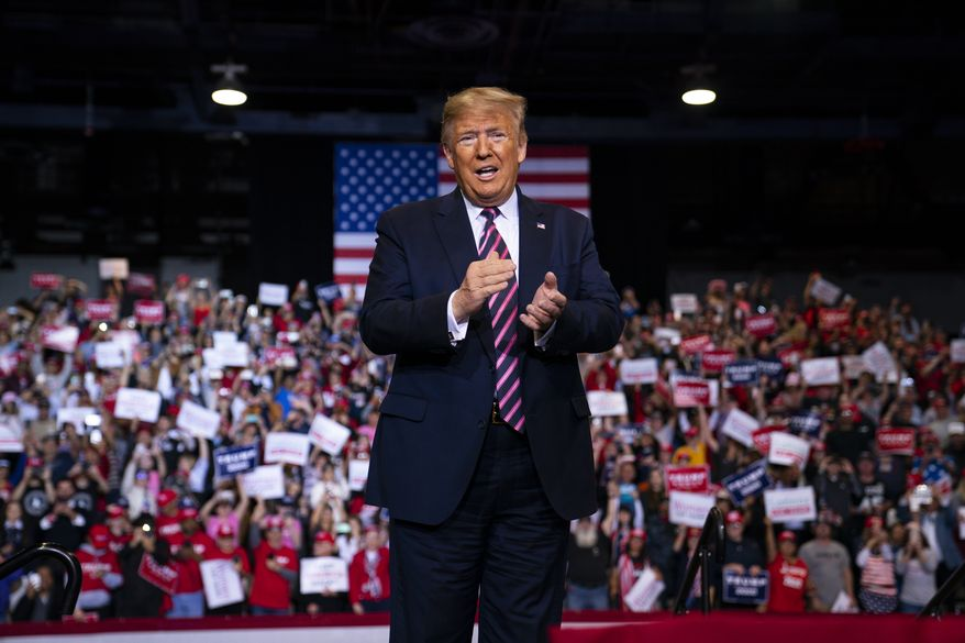 President Donald Trump arrives to speak to a campaign rally at the Las Vegas Convention Center, Friday, Feb. 21, 2020, in Las Vegas. (AP Photo/Evan Vucci)