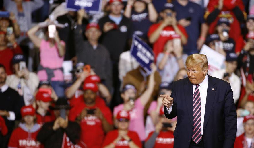 President Donald Trump pauses as he walks offstage after speaking at a campaign rally, Friday, Feb. 21, 2020, in Las Vegas. (AP Photo/Patrick Semansky)