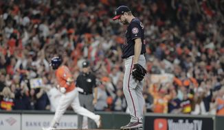 FILE - In this Oct. 30, 2019, file photo, Houston Astros' Yuli Gurriel hits a home run off Washington Nationals starting pitcher Max Scherzer during the second inning of Game 7 of the baseball World Series in Houston. The last time these teams played the Nationals were celebrating their World Series title in Houston. Since then the Astros have become the league's villains, with a sign-stealing scandal tarnishing their reputation and casting a shadow on their 2017 title. (AP Photo/David J. Phillip, File)