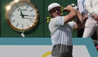 Bryson DeChambeau of the United States follows his tee off at the tenth hole during the second round for the WGC-Mexico Championship golf tournament, at the Chapultepec Golf Club in Mexico City, Friday, Feb. 21, 2020. (AP Photo/Fernando Llano)